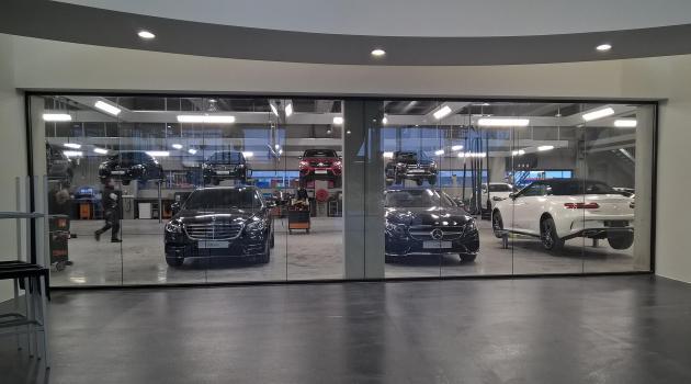 Garage Ghisterlynck (Kuurne) - Binnenwand in gelaagd glas Stratobel